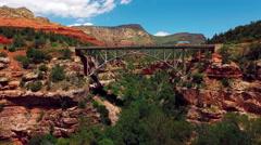 Aerial - Bridge Fly Under - Sedona, Oak Creek Canyon Stock Footage