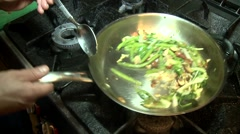 Chef cooking vegetables in the restaurant kitchen stove Stock Footage