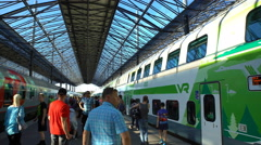 A lot of passengers on a platform at the railway station. Time lapse. Stock Footage