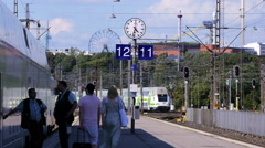 Passengers and train on the platform of the railway station. Time Lapse. Stock Footage