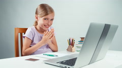 Portrait student girl 7-8 years looking at laptop with big eyes Stock Footage