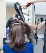 Blow-drying in a beauty salon Stock Photos