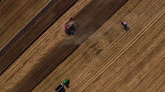 Sunset and Working Harvesting machines Combines and tractors in the Field Stock Footage