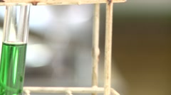 Green liquid inside test tubes in a laboratory Stock Footage