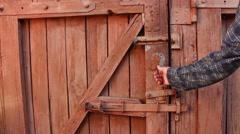 A men unlocks the door using key Stock Footage