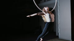 Circus performer hanging on aerial hoop and doing some acrobatic elements Stock Footage