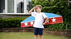 Super Hero Pilot Boy Playing Outside of Home Stock Footage