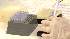Laboratory worker putting samples in tubes with micropipette Stock Footage
