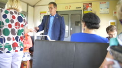 Controller checks the tickets on the train passengers Stock Footage
