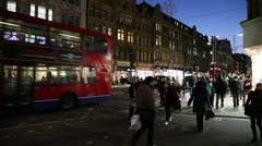 Traffic taxis and bus from London at night Stock Footage