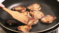 Fry the meat in a frying pan, Chef preparing and spicing meat restaurant kitchen Stock Footage