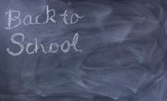 Back to school text on erased chalkboard Stock Photos