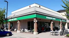 Store front of Starbucks coffee shop on sunny day in Coquitlam Canada Stock Footage
