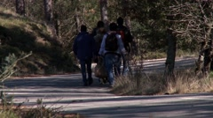 People walking in a rural mountain road Stock Footage