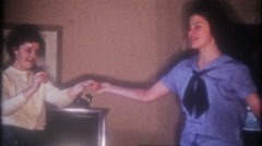 3488 teenage girls swing dancing to the radio at home-vintage film home movie Stock Footage