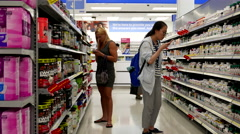 People choosing health foods at pharmacy section inside Walmart store - stock footage