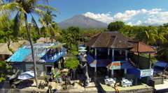 Beach in Tulamben with view of Agung volcano, aerial shot Stock Footage