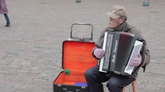 Man playing accordion in old town warsaw, poland Stock Footage