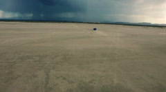 El Mirage Dry Lake Bed - Stormy with a Blue Subaru Stock Footage