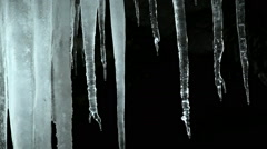 Cold water dripping from ice stalactites Stock Footage