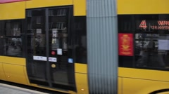 Pubblic transportation yellow tram in warsaw, poland Stock Footage