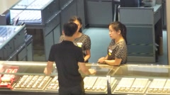 People are buying jewelry at a jewelry store. - stock footage
