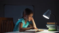 Portrait profile child reading a book in the night Stock Footage