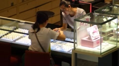 People are buying jewelry at a jewelry store. Stock Footage
