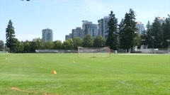 City sport field, man jogging in front of camera. Stock Footage