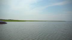 Luxury boat near the marsh and dock of Ho Hum beach on Fire Island - stock footage