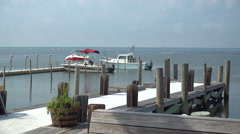 Wide view of dock at Ho Hum beach on Fire Island Stock Footage