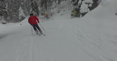 Tracking shot of man skiing on snowcapped mountain, Laax, Switzerland Stock Footage