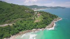 Approach Shot Over Rocky Headland and Coastal Road in Phuket Thailand Stock Footage