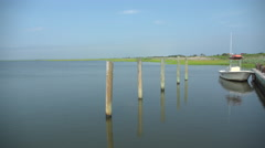 Dock at Ho Hum beach on Fire Island on a sunny day - stock footage