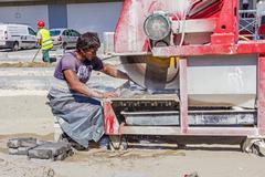 Zrenjanin, Vojvodina, Serbia - September 14, 2015: Worker using abrasive acti Stock Photos
