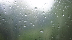 Close-up of water droplets on glass. Rain drops on window glass Stock Footage