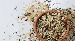 Wild rice rotating in a container Stock Footage