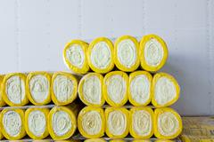 Stack of thermal insulation material in roll is wrapped with cellophane foil Stock Photos