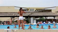 Kirillovka, Ukraine - Pool Party. Girl-animator demonstrates Stock Footage