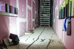 Floodlight light at building site illuminates long passage Stock Photos