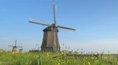 CLOSE UP: Beautiful traditional wooden windmill in lowland grassy countryside - stock footage