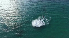 Man flying over sea on flyboard. Aerial view from copter Stock Footage
