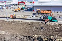 Road Construction. Asphalt spreader Stock Photos
