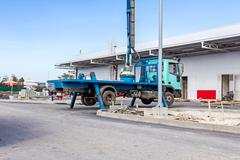 Truck with elevated bucket has lateral stabilizer extended to make better sta Stock Photos