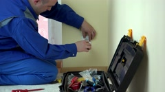 Worker electrician repair an electrical outlet in apartment Stock Footage
