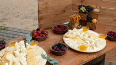 Festive wooden table on the street with different food in Welkom Stock Footage