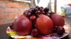Close view of different fresh fruits, nectarines and cherries Stock Footage