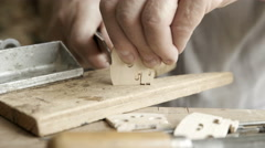 A luthier makes violin bridge. Close up Stock Footage