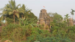 Temple between trees at Bindu Sagar lake,Bhubaneswar,India Stock Footage