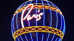 Zoom Out - Paris Casino Sign Balloon at Night - Las Vegas Stock Footage